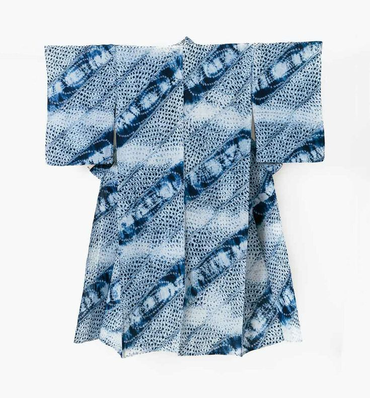 """This is a vintage Japanese shibori yukata,a kind of cotton kimono for  summer.  Mixed shibori techniques or miura, ori-nui, and kanoko are used to achieve  a beautiful and complex pattern of stripes, breaks, and whirlpools in  watery blue.In excellent condition.  Mid 1900s Dimensions: 49.75 x 56.25""""; 126 x 143cm"""