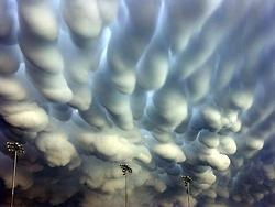 "These ""mammatus clouds"" were photographed above Hastings, Nebraska, after a destructive thunderstorm in May 2005. Although their formation is not completely understood, these rare clouds usually develop at the base of a thunderstorm, and appear lumpy because of instabilities and temperature differences between sinking and rising air."