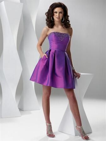 Short & Sweet in Purple for Prom this year.  Love the crystals at the top of the bodice, nothing like bling to get the night started right!