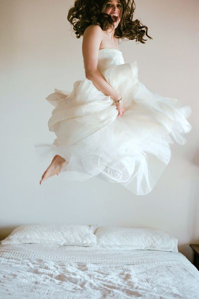 Because on your wedding day, no one can tell you not to jump on the bed!