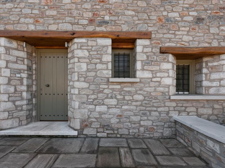 Windows _ exterior | design | front door | window | stone | holiday house | sea | Pelion | Sporades | traditional | local architecture | Pagasitikos Bay _ visit us at: www.philippitzis.gr