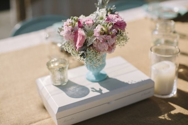 aqua mint milk glass goblet centerpiece with pink and white flowers on a white painted wooden platform, rustic glam ranch wedding, Danielle Capito Photography