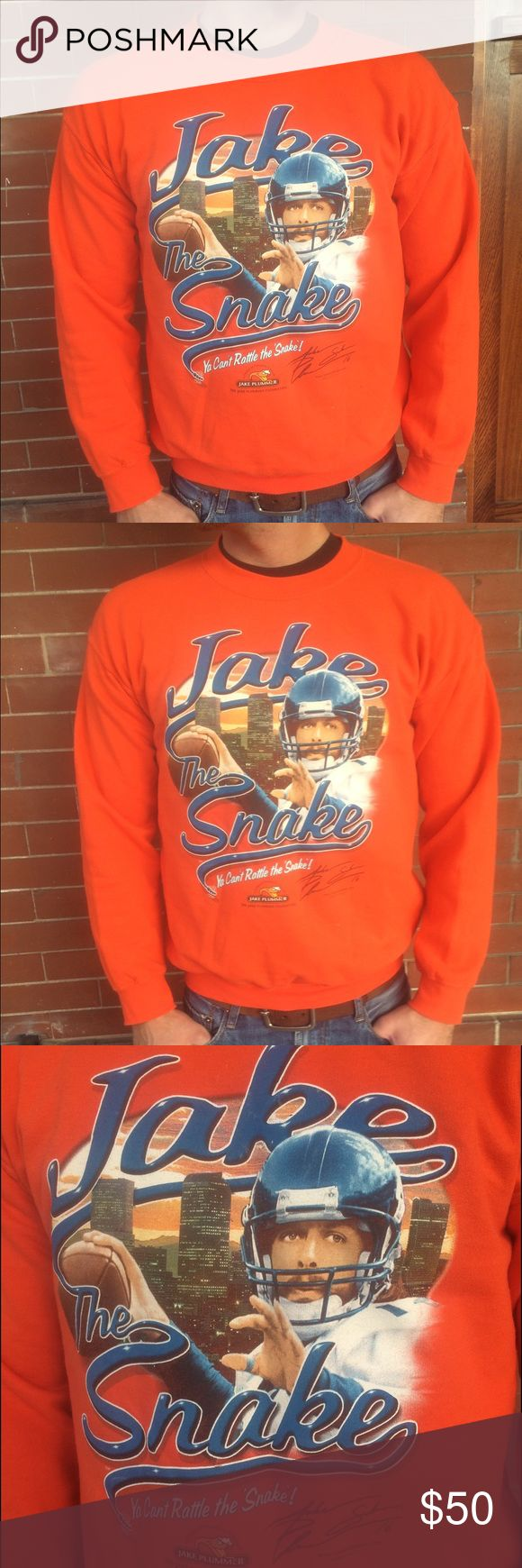Denver Broncos Jake Plummer Sweatshirt Rare 2005 🏉Denver Broncos Jake Plummer Sweatshirt.  Ya can't rattle the 'snake' 🐍Excellent condition.  Denver city skyline 🌇in background, vibrant color. Cotton poly blend.  Size Men's mediumship ♏️. Can be unisex. Sweaters