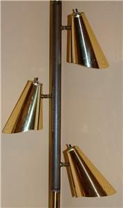 Pole lamp - we had one just like it. Both grandparent had them too. - You mean these went out of style? I still have one.