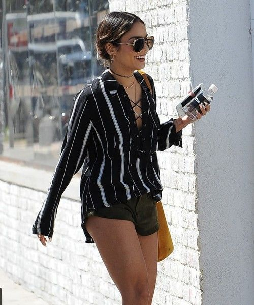Vanessa Hudgens Photos Photos - Actress Vanessa Hudgens stops by the Alfred Coffee & Kitchen for an iced coffee while out and about in West Hollywood, California on September 15, 2016. Vanessa was too concerned with answering text messages while she crossed the street instead of checking for oncoming cars. Afterwards, she was spotted shopping. Vanessa visited All Saints and bought some clothes before heading back to her car. - Vanessa Hudgens Stops For Iced Coffee In West Hollywood