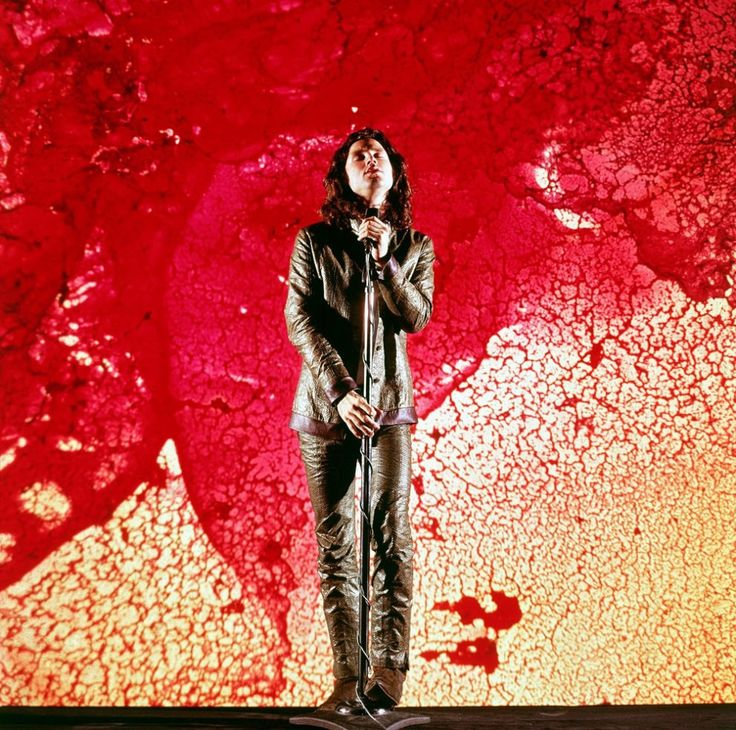 """Among the counterculture protagonists LIFE sought to fathom & perhaps, explain to its millions of readers was Jim Morrison, the lyricist & front man for the Doors. For a LIFE feature titled """"Wicked Go the Doors: An Adult's Education by the Kings of Acid Rock,"""" the writer Fred Powledge studied Morrison through his lyrics & his notorious onstage antics. But not being at a Doors concert, pictures, like these by LIFE's Yale Joel — best illuminate the mojo that came to define the """"Lizard King."""""""