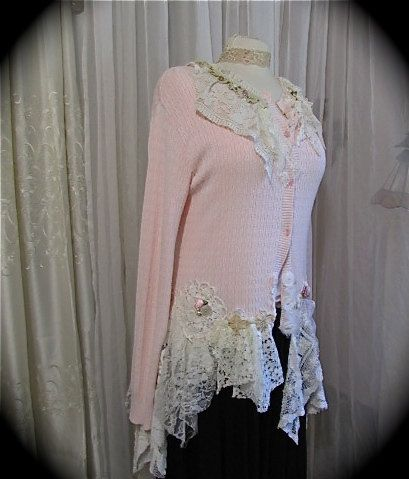 Lovely pink sweater refashioned tattered shabby cottage style. The sweater is very soft feeling. There are buttons on the front for closure,