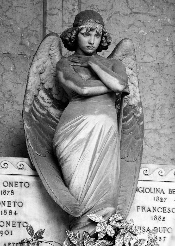 The Oneto Tomb, Genova. Sculptor - Giulio Monteverde ...The Angel, who guards the urn, is admired for the perfect moulding of the arms, neck and head, the deep and soft expression of grief which appears on his features...S)