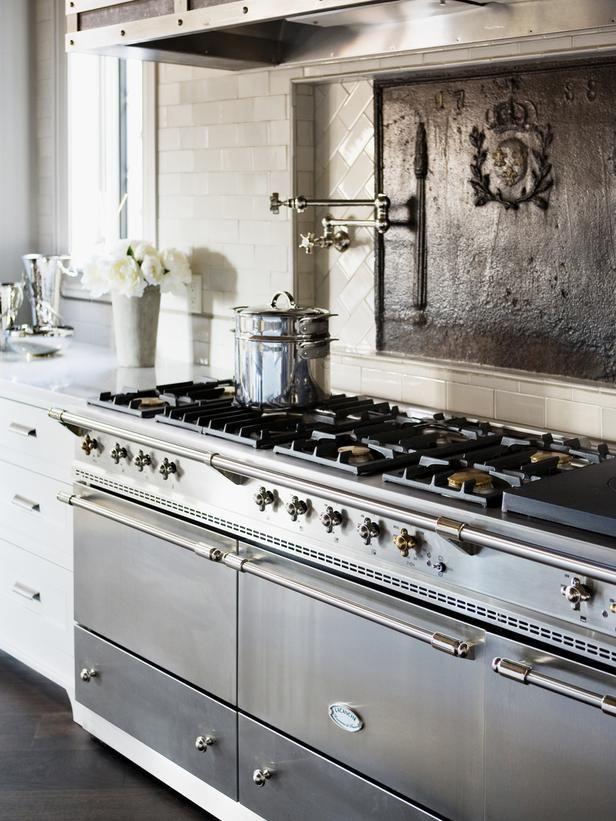 antique-iron fireback - nice idea for a backsplash to a stove, especially when you need some dark contrast; Linda McDougald