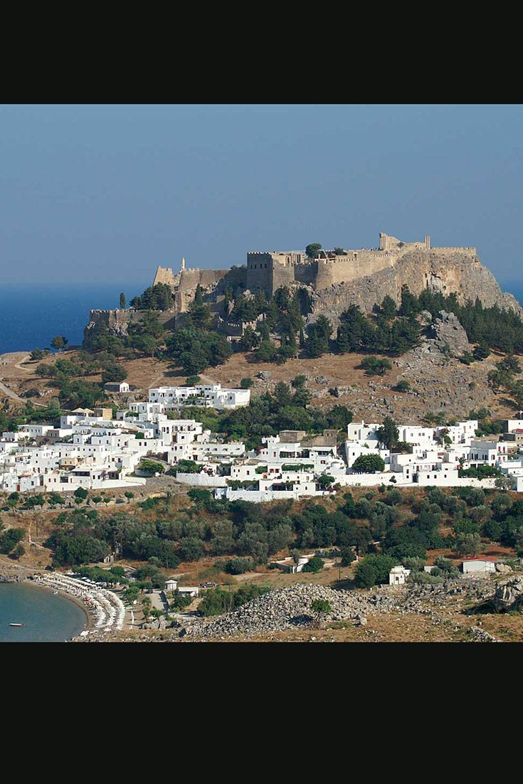 Lindos in Rhodes. Photo displays the city with the Acropolis on its top. #archaeology, #castle , #fortress, #Greece