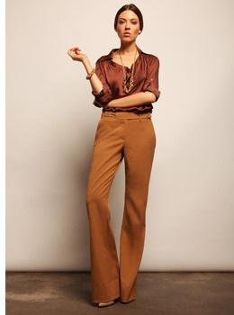 Rust silk blouse and tan pants