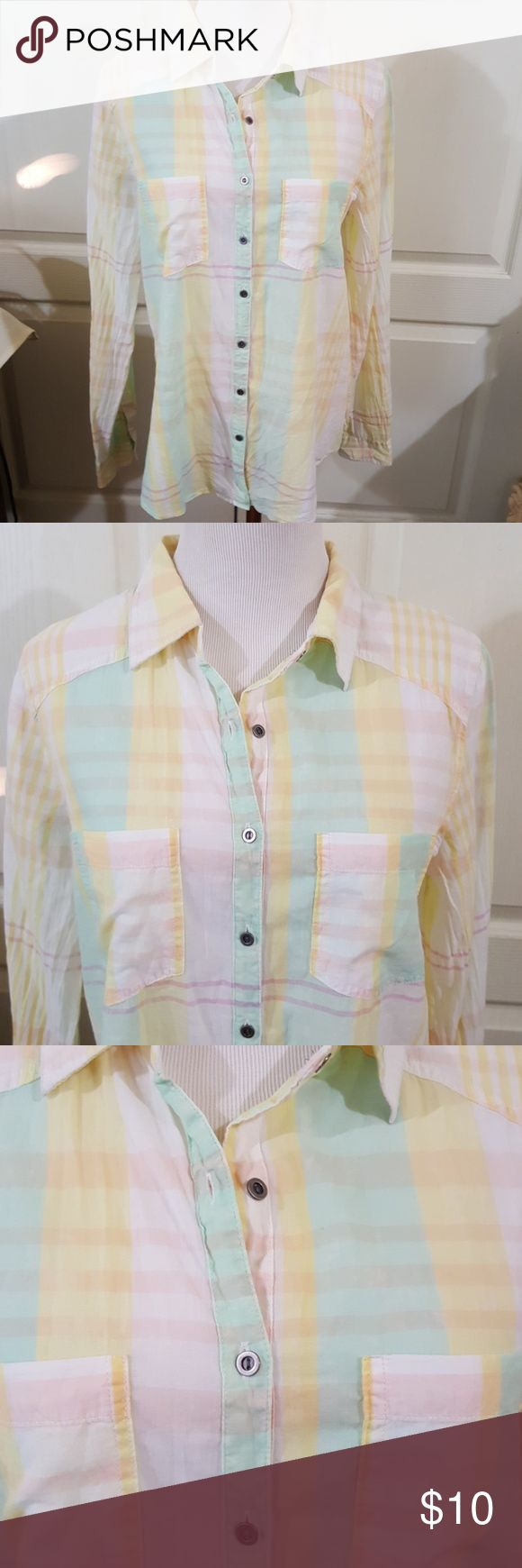 NWT Maurices Button Down Shirt. Sz. Medium Long sleeve button down by Maurices. It's new with tags but has a stain on it. See pic 6. I don't know what the stain is or if it will or won't come out. I haven't tried removing it. I didn't even notice it when I bought it. Lightweight and soft. Pretty pastel colors. Size Medium. Maurices Tops Button Down Shirts