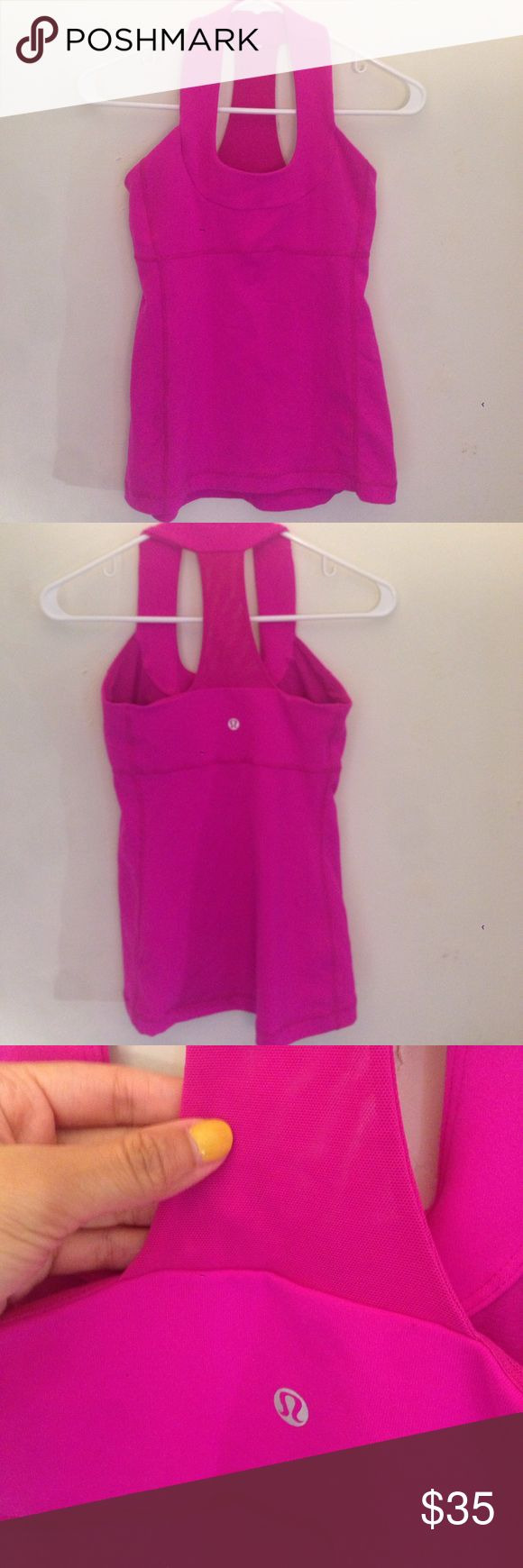 Lululemon Hot Pink Tank Top Halter Style size 4 May have teeny tiny piling but overalll it is in very good condition. The brand tag is missing but size is pictured. Has built in bra lululemon athletica Tops Tank Tops