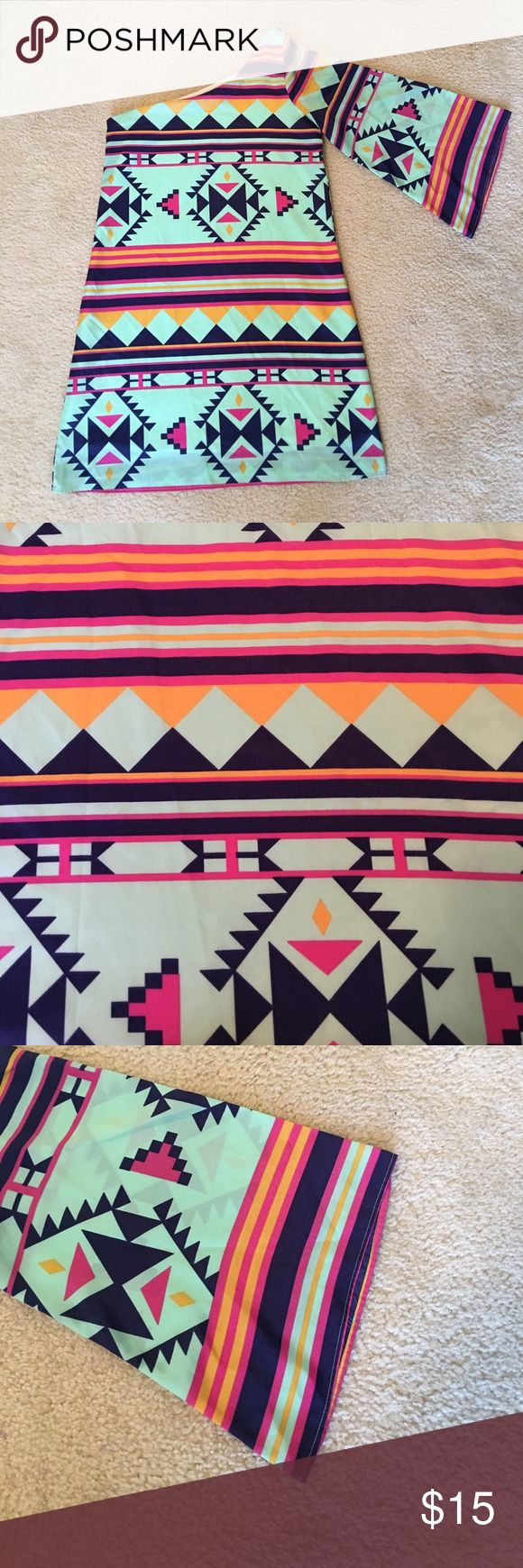"Bright fun one shoulder Aztec print dress 33"" long. Sleeve has flare. Bright pretty colors and pattern! Perfect for summer. Measures 17"" pit to pit. always Dresses Mini"