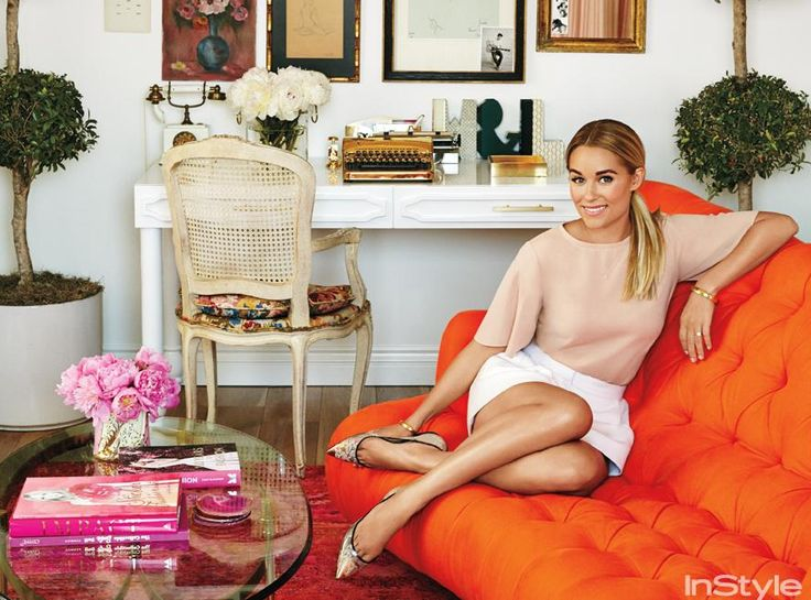 """Inside Lauren Conrad's Beverly Hills Penthouse   InStyle.com THE OFFICE Stacks of fashion books are a mainstay in Lauren Conrad's home office. The rug is made from recycled silk saris; the couch is upholstered in a complementary punchy shade. """"I always gravitate toward feminine details,"""" said Conrad. """"On a garment it's a bow; on a sofa it's tufting."""""""