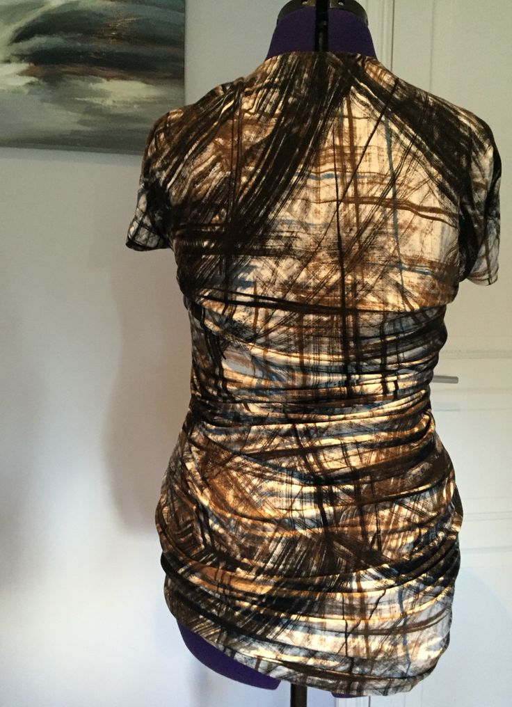 """Camo top, back, by nina dirix, pattern guidance with credits to""""Pattern magic"""""""