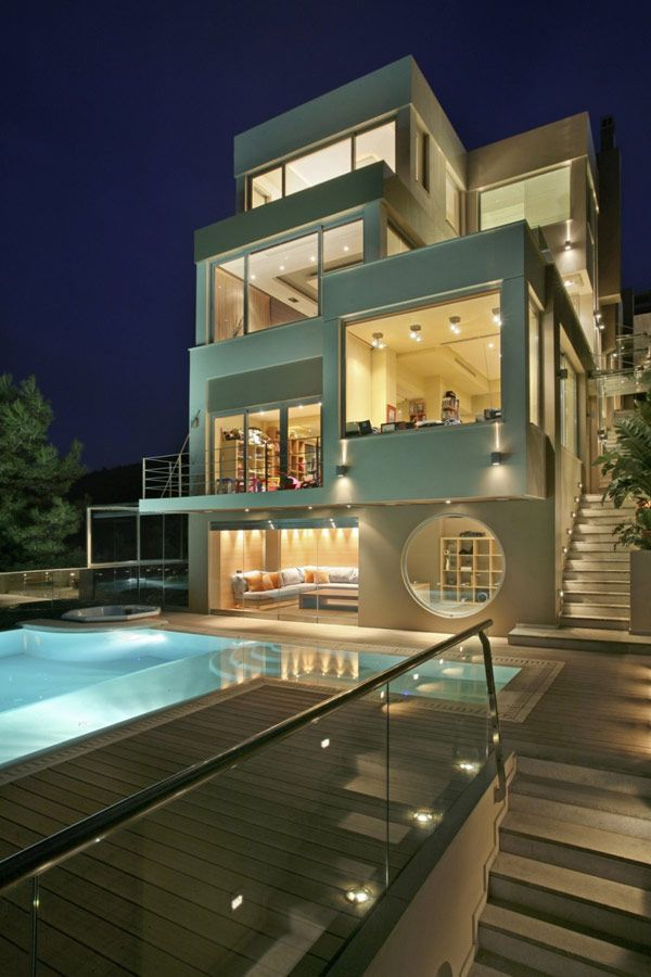 Designed by Dimitris Economou, Oikia Voulas Panorama is an opulent villa in Athens, Greece.