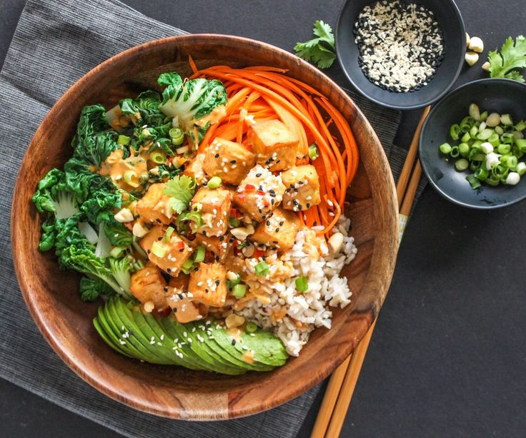 Fluffy rice, steamed bok choy, carrots, soft avocado and perfectly-golden-crisp tofu: This Thai Peanut Tofu Buddha Bowl will get your tastebuds singing!
