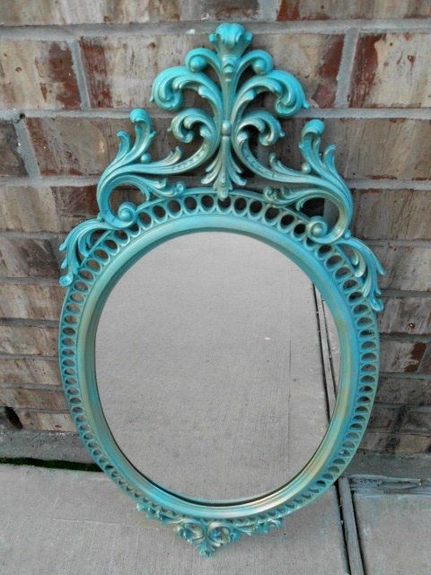 I have this same mirror!! I spray painted it gold though....