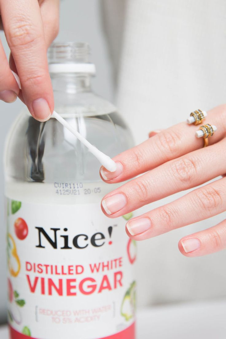 Use a cotton swab to wipe down your nails with white vinegar before applying basecoat.