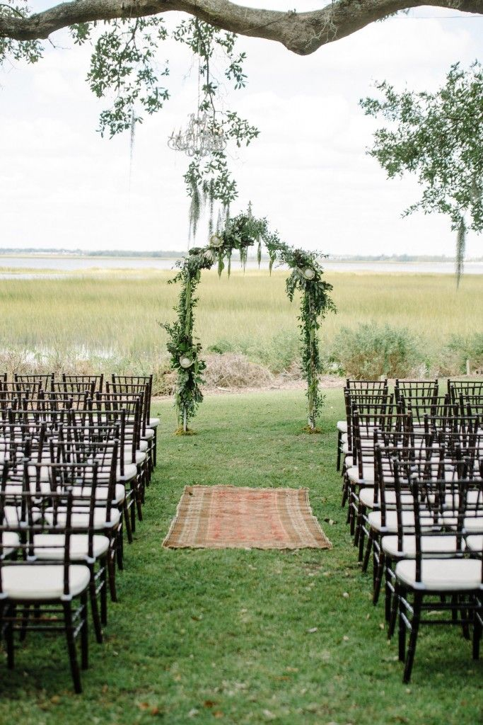 make a statement at your wedding ceremony with dark woods, lush greenery and a statement oriental runner just like this from ooh! events #ceremony #wedding #decor http://www.theartofcreating.com/blog/the-colors-of-2014/