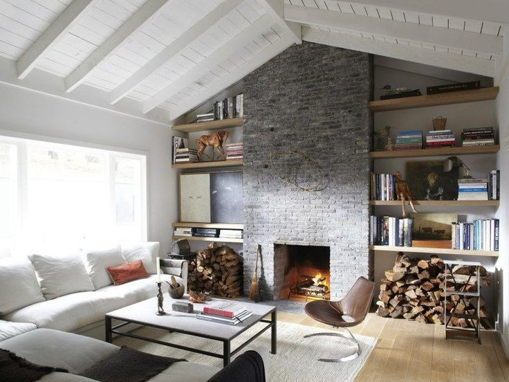 Kick Back And Relax In This Neutral Living Room. Exposed Beams And A Stone  Fireplace