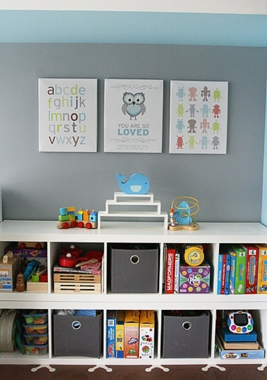 Good idea for organization in a kid's room; if he climbs on it, it's not a far fall.