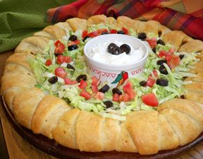 Taco Ring Recipe. 1 lb. ground beef  taco seasoning to taste  1 c. Cheddar cheese - shredded  2 packages Pillsbury Crescent Rolls.  Lay crescent rolls around a baking stone with the wide ends (end opposite from the points) along the outer edge of the round baking stone and the narrow points meeting in the center. Put a spoonful of meat mixture on each crescent roll. Roll crescent rolls up with meat mixture inside.  Place on the outer edge of the baking stone. Bake at 350 until rolls are…