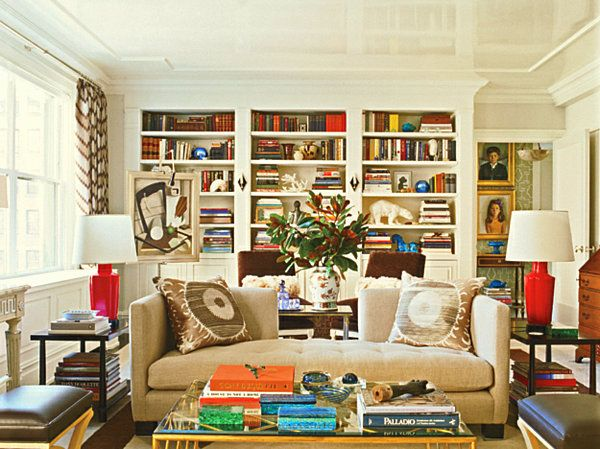 Books, vases and figurines are incorporated into the shelf arrangements to create symmetry. (via @Decoist.com.com www.decoist.com) http://www.decoist.com/2012-05-21/20-bookshelf-decorating-ideas/