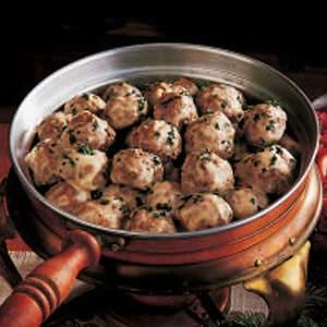 "Meatballs and Gravy Recipe -""CHRISTMAS was the time when our family forgot about the food budget and splurged on one special meal. I can still see Grandmother making dozens of these little meatballs! The hint of spices gives them a savory taste that makes them authentically Norwegian."""