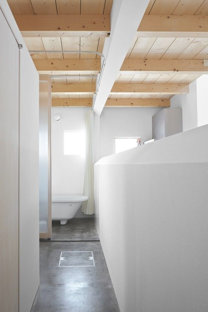 Concrete floors combined with radiant floor heating are welcome anywhere in the house, particularly in the bathroom (as seen in this Hokkaid...