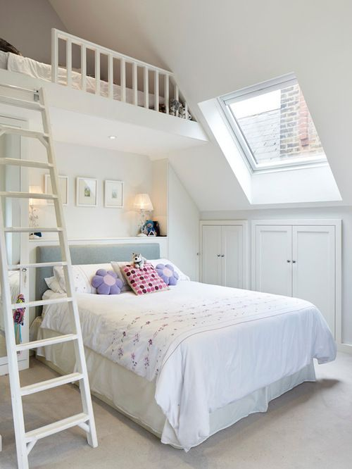 A loft bedroom with built in storage.