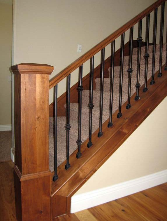 wrought iron stair railings with wood steps
