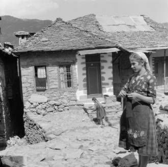 Greece, woman knitting outside homes in Métsovon :: AGSL Digital Photo Archive - Europe