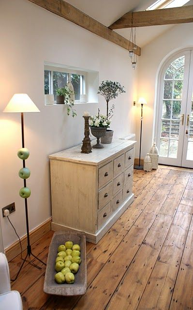 Invite the outdoors in from the ground up with floors made from natural elements. Wood is an obvious choice, from oak to bamboo. Pine planking works well in a country or primitive-style home, while oak tongue-and-groove flooring is more appropriate for a traditional one. Check out floors manufactured with other natural materials such as flagstone and cork. If new flooring isn't in your budget, consider laying area rugs crafted from organic materials such as cotton and coir.