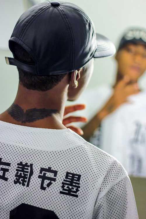 neck wing tattoo man