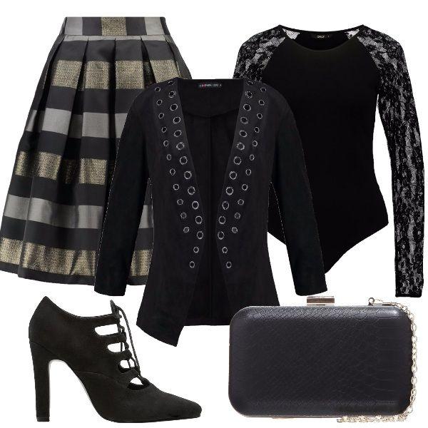 Una bambolina in stile rock, certamente rivisitato e addolcito. Veste in gonna, a campana e a righe, abbina un body sexy, con maniche in pizzo, un blazer nero, con borchie, pochette a tracolla, con dettagli argentati e francesine nere, con tacco alto.