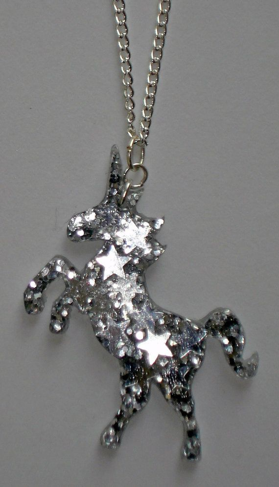 Silver stars and glitter unicorn necklace by ToxicGlamour on Etsy, $7.00 Sold but other silver, pink, rainbow and multicoloured unicorns available