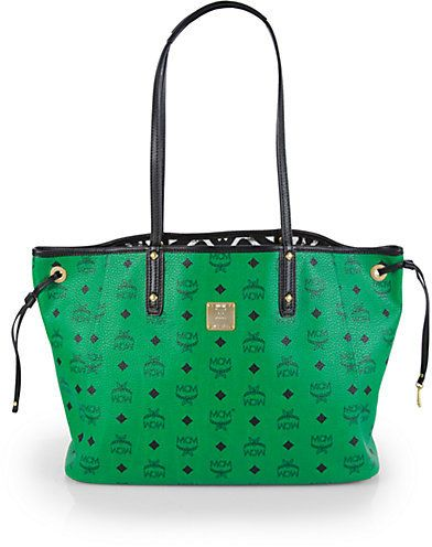 $715, Green Tote Bag: MCM Shopper Project Visetos Medium Coated Canvas Reversible Shopper. Sold by Saks Fifth Avenue.