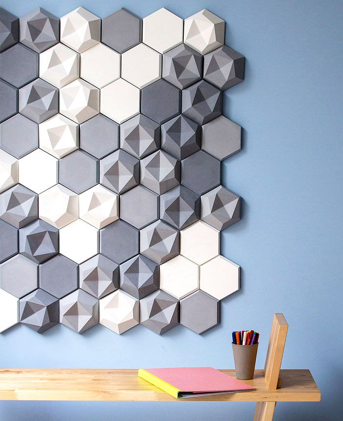 'Edgy's' asymmetry enables the designer to create a multitude of patterns, allowing flexibility and individuality, as well as a wide range of use: from decorative surfaces, guidance systems or even the integration of corporate identities.  Designers Patrycja Domanska and Tanja Lightfoot launched new concrete tile collection 'Edgy', manufactured by KAZA Concrete.