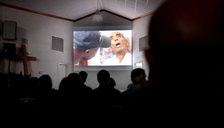 Inmates at the Louisiana State Penitentiary in Angola, La.,  watch the screening of the documentary 'Serving Life,' by director Lisa R. Cohen, about the volunteer hospice work done by inmates for inmates dying in the prison, Thursday, July 21, 2011. (AP Photo/Gerald Herbert)