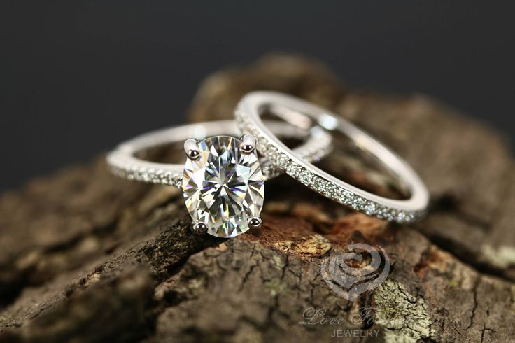 Certified 9x7mm/2.10 Carats Forever One Oval G-H Color Moissanite 14k White Gold Diamond Ring &Mia 14k White Gold Half Eternity Diamond Band by loveforeverjewelrysv on Etsy https://www.etsy.com/listing/523618748/certified-9x7mm210-carats-forever-one