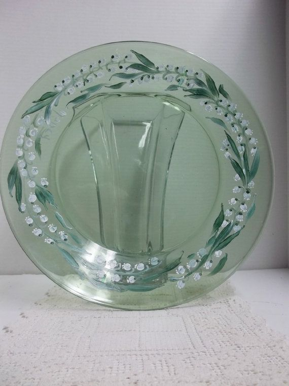 Vintage 13 green depression glass plate hand painted in a scandinavian folk art style of My Garden, my Lily of the Valley garden. It is a beautiful plate with no nicks or dings or utensil marks.It will make a wonderful serving piece on someones table. It was hand painted using acrylic enamel paint. Hand washing is recommended. Artist signed.