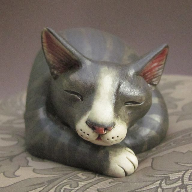 Hand sculpted figurine of sleeping gray tabby cat by Felicia Nilson