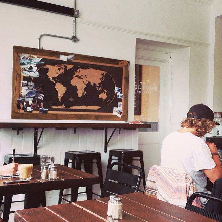 Stylish World Map Cork Pinboard in Coffee Shop, Newquay, Cornwall, UK.