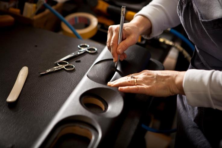 Carefully folding leather at the edges