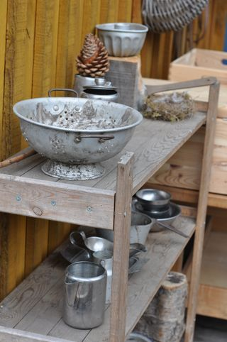 I had a mud kitchen cabinet when I was little. My grandma stocked it with cookie cutters and bowls and all the things you see here. It sat near the spigot of an artesian well that produced the coldest, clearest water needed for the best mud cuisine.