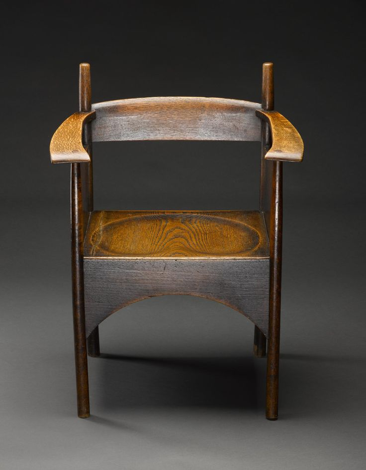 Oak armchair with panelled sides and a deep apron, from the Argyle Street Tearooms (used in the Smoking and Billiards Rooms), Glasgow, designed by Charles Rennie Mackintosh, 1898, made at the workshop of Francis Smith, Glasgow, 1898-99
