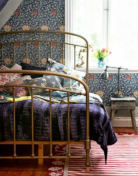 Lovely William Morris-y (is it William Morris?) wallpaper, great bed frame.