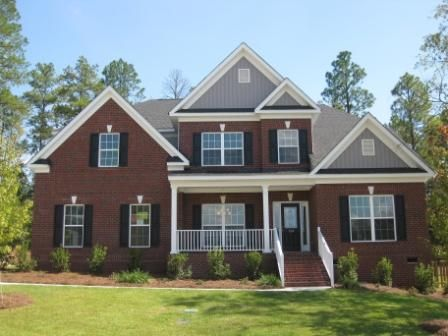 Traditional brick home in Lake Carolina by Essex Homes.  http://www.lakecarolina.com/details.aspx?hid=877#